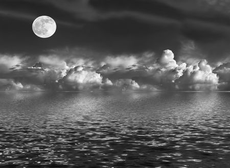 Abstract of a stormy night sky with cumulus clouds and a full moon on the spring equinox, reflected over water. In monochrome photo
