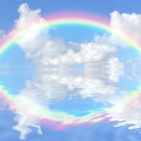 Abstract fantasy of a blue sky and rainbow with cumulus clouds reflected over rippled water. Stock Photo