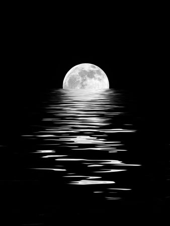 Abstract of a full moon on the Spring Equinox reflected over water and set against a black background. Stock Photo