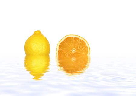 Abstract of a lemon and orange slice reflected in gently rippled blue water and set against a white background. Stock Photo - 2661419