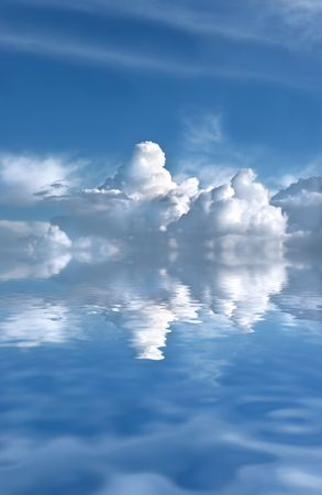 Abstract of a blue sky with dark cumulus storm clouds reflected over rippled water. Stock Photo - 2807948
