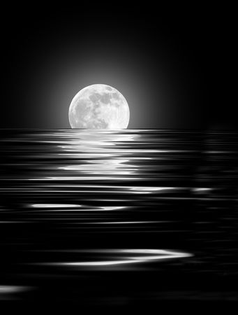 Abstract of a full moon on the Spring Equinox reflected over rippled water and set against a black background. photo