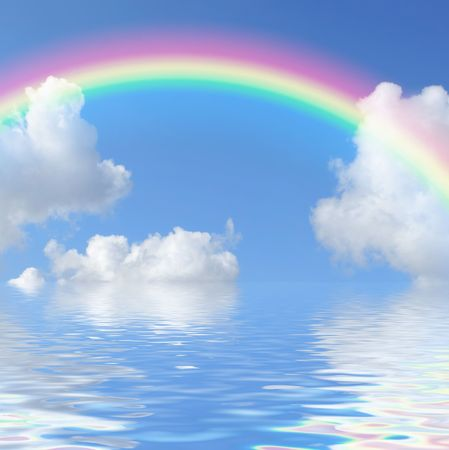 Fantasy abstract of a blue sky and rainbow with cumulus clouds and reflection over water.