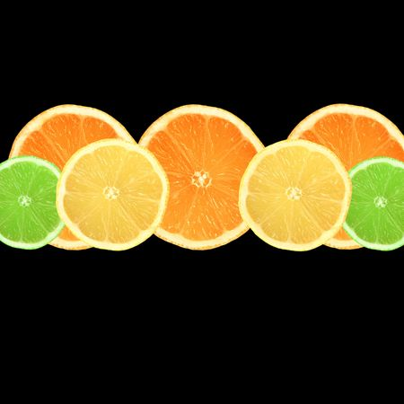 Lemon, lime and orange citrus fruit slices in a horizontal line over black background. Stock Photo - 3487604