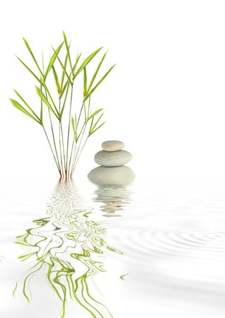 serenity: Zen abstract of grey spa stones and bamboo grass with reflection in rippled water, over white background.