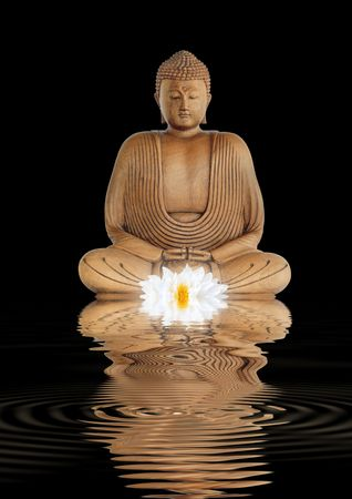 Buddha in contemplation with a glowing white lotus lily and reflection in rippled water, over black background. photo