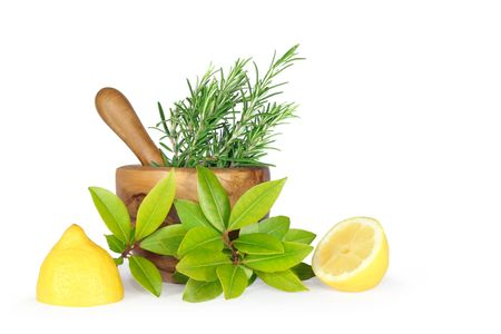Herb leaf selection of rosemary, bay and two lemon halves, with an olive wood pestle and mortar to the rear. Over white background. Stock Photo - 3658019