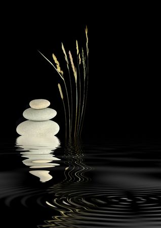 Zen abstract of wild grass and grey spa stones with reflection in rippled water, over black background.