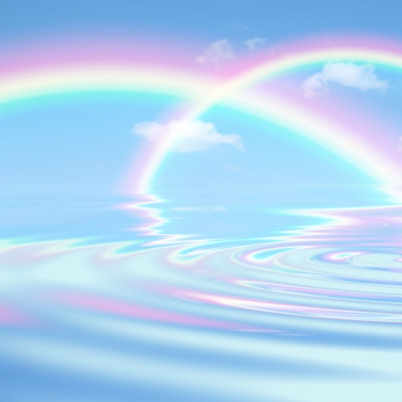 Rainbow fantasy abstract against a blue sky and clouds with reflection over rippled water. Stock Photo - 3689654
