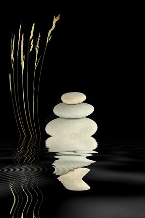 Zen abstract of grey spa stones and wild grass with reflection over rippled water, over black background. photo