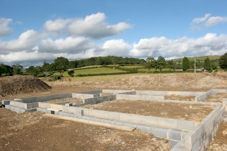 Concrete  block foundations for a new building on a construction site in rural countryside.  Stock Photo