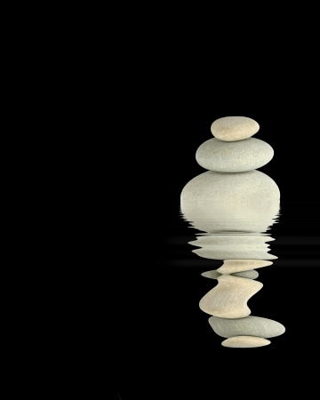 Zen abstract of three gray spa in perfect balance with reflection over rippled  water, against black background. photo
