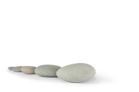 Zen abstract of five gray spa stones, over white background. Focus on the front stone. photo