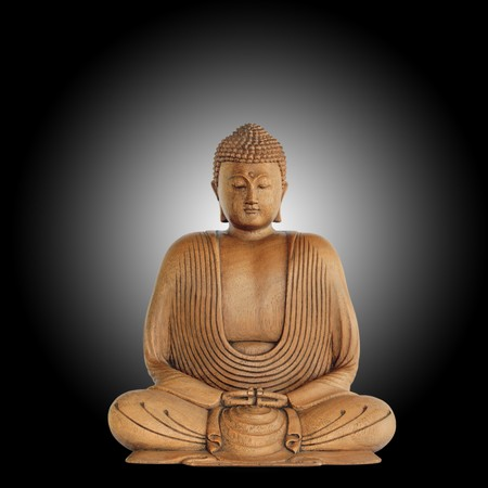 Smiling buddha with eyes closed in prayer against a black background with white central glow.