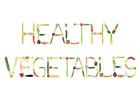 Vegetable selection spelling the words healthy vegetables, over white background. photo