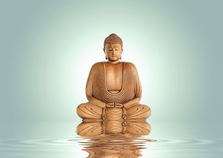 Buddha in meditation with reflection over rippled water, set against a pastel green background with white central glow. photo