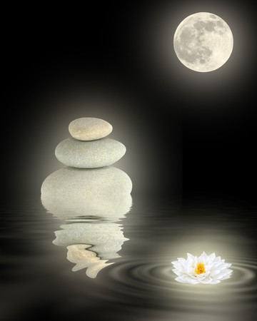 healing with chi: Zen garden abstract of glowing gray spa stones, white japanese lotus lily and full moon with reflection over rippled water, over black background.