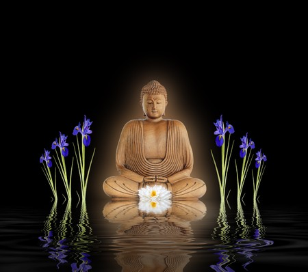 smiling buddha: Zen abstract of a buddha with glowing aura, a white lotus lily and blue iris flowers with  reflection over rippled water. Over black background. Stock Photo
