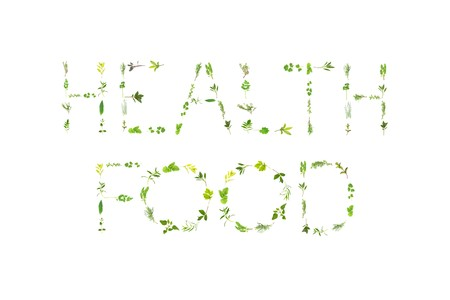 Herb leaf sprigs, spelling the words health food, over white background. photo