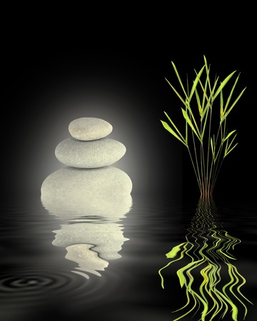 Zen garden abstract of glowing grey spa stones in perfect balance and bamboo leaf grass with reflection over rippled water, against  black background. photo
