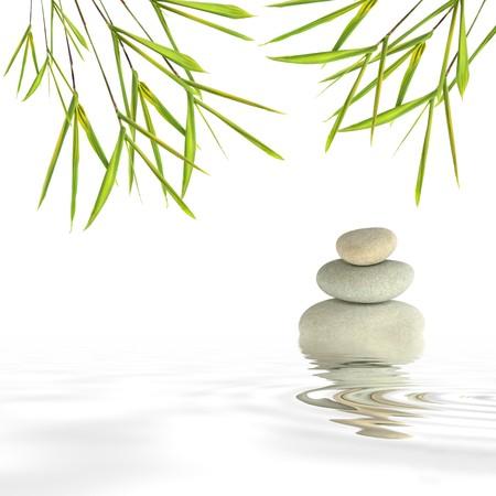 Zen abstract van grijze stenen spa in perfecte balans en bamboe blad gras met reflectie over rippled water, tegen een witte achtergrond.
