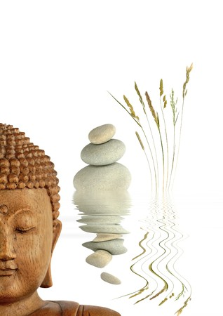 Zen abstract of the face of a buddha, with natural grey spa stones in perfect balance and wild grasses with reflection in rippled water, with over white background. photo