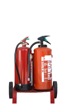 Two red fire extinguishers on a trolley with wheels, isolated over white. Stock Photo