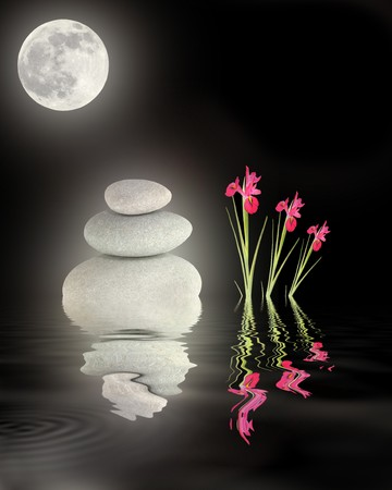 Zen abstract of glowing grey spa stones in perfect balance with red iris flowers and a full moon with reflection over rippled water, against black background. photo