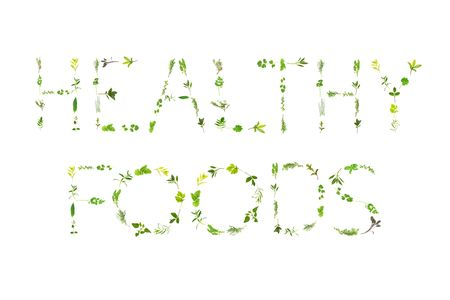 Herb leaf sprigs, spelling the words healthy foods, over white background.  photo