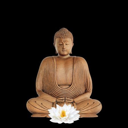 chinese philosophy: Buddha with eyes closed in prayer and a white japanese lotus lily flower, over black background.