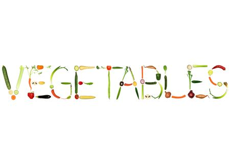 Vegetable selection spelling the word vegetables, over white background. photo