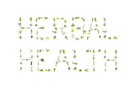 Large selection of herb leaf sprigs, spelling the words herbal health, over white background. Stock Photo - 4986545