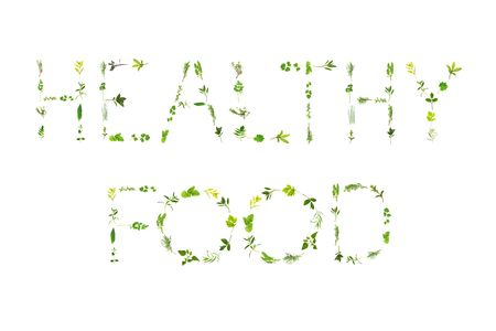 Large selection of herb leaf sprigs, spelling the words healthy food, over white background. Stock Photo - 5071730