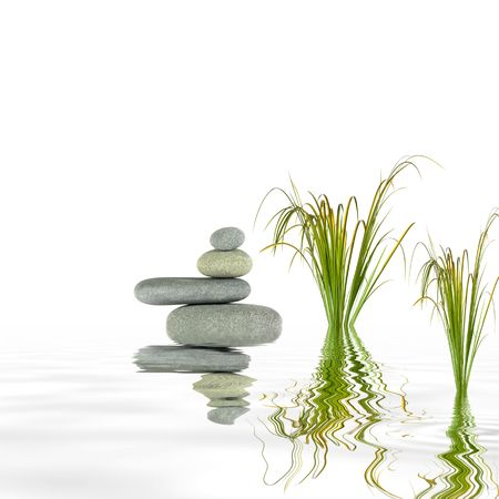 grey water:  Zen garden abstract of spa stones in perfect balance with bamboo leaf grass and reflection in rippled grey water, over white background.