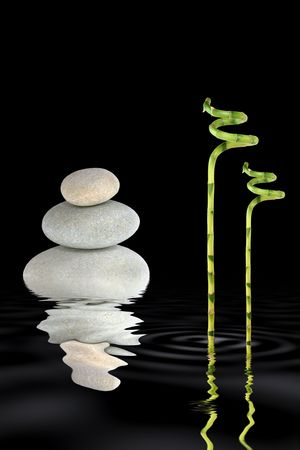 tough luck: Zen abstract of grey spa stones in perfect balance and lucky bamboo grass with reflection in rippled water, over black background. Stock Photo