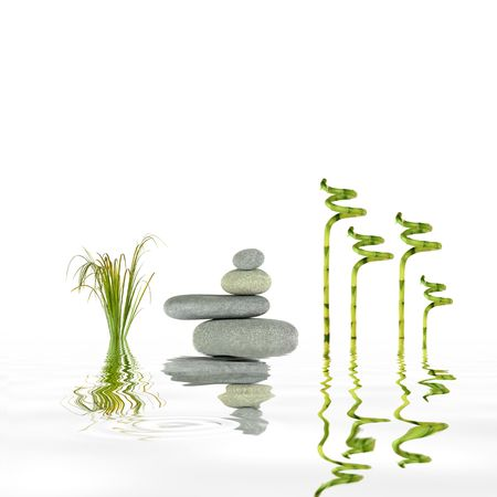 Zen garden abstract of grey spa stones in perfect balance with lucky bamboo leaf grass and reflection in rippled water. photo