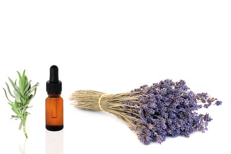 Lavender dried herb flowers and essential oil glass dropper bottle with leaf sprig, over white background. Stock Photo - 5301233
