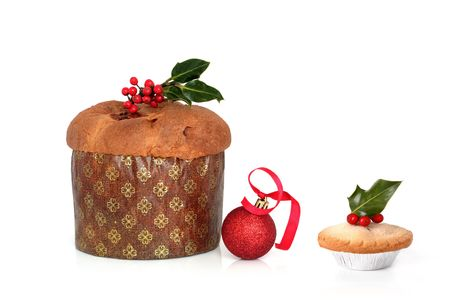 Christmas panetone cake and mince pie with holly leaves and berries and red sparkling bauble with ribbon, over white background. Stock Photo - 5596824