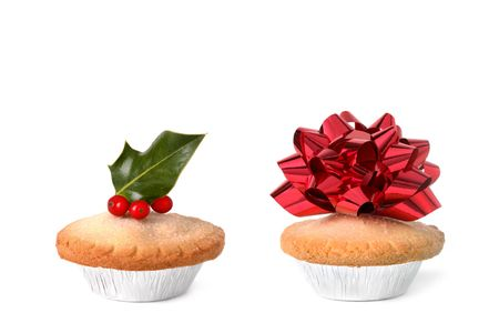 Christmas mince pies with red ribbon bow and holly leaf with berries on top, over white background. Stock Photo - 5766201