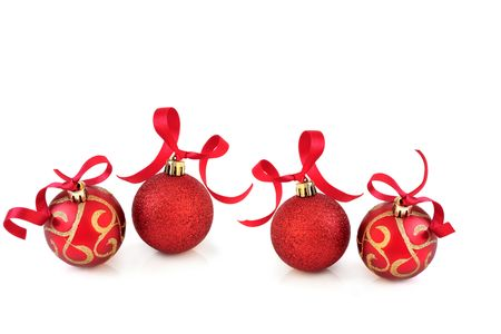 Christmas baubles in sparkling red and gold with ribbons, over white background with reflection. Stock Photo - 5766210