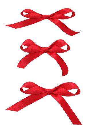 Three satin red ribbon bows in  different sizes over white background. Stock Photo - 5816626