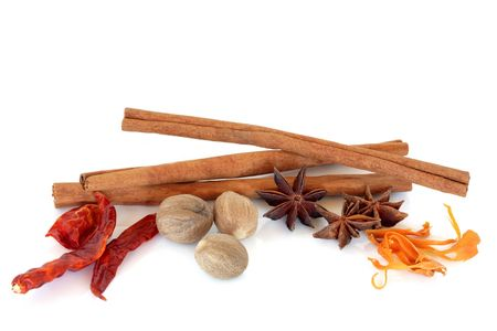 mace: Spice selection of nutmeg, star anise, chilli, mace and cinnamon sticks, over white background.