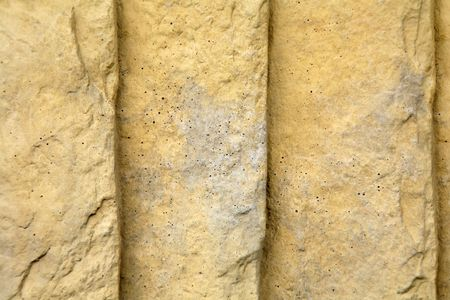 ridged: Ridged and textured golden colored  sandstone background.