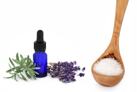 Lavender herb flowers and leaf sprig with an aromatherapy essential oil glass dropper bottle and wooden ladle with sea salt, over white background. Stock Photo - 5909239