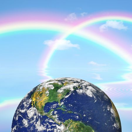 Planet earth against a background of double rainbows and a blue sky with reflection over rippled water. Stock Photo - 5958011