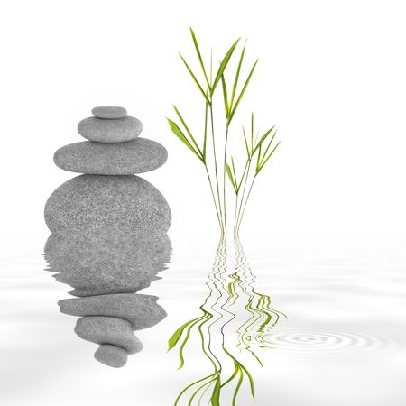 Zen garden abstract of grey stones in perfect balance and bamboo leaf grass, with reflection in rippled water, over white background. photo