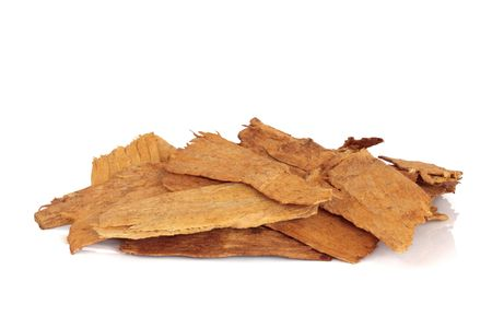qui: Astragalus root used in chinese herbal medicine, isolated over white background. Astragali radix, Zhi Huang Qui. Stock Photo