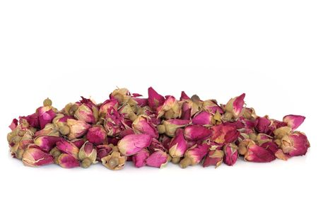 Dried rose flower buds used  in chinese herbal medicine, over white background.  Rosae rugosae. photo