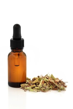 valerian: Valerian herb root and essence dropper bottle, over white background. Modern day alternative equivalent to valium acting as a tranquilizer.