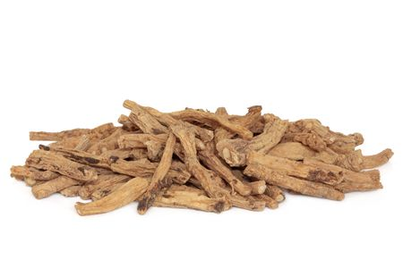 codonopsis roots: Dried codonopsis root used in chinese herbal medicine, isolated over white background. Dang shen. Radix codonopsitis pilosula. Stock Photo